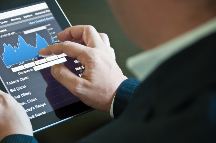 Closeup of a businessman accessing his digital tablet PC
